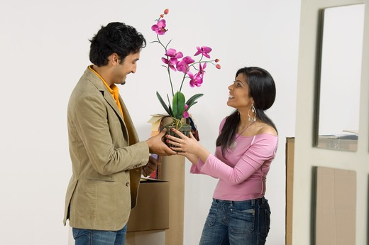 Stock Photo: 4304R-4989 Young woman moving into a new home