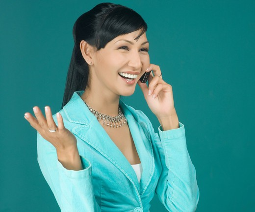 Stock Photo: 4304R-5043 Young woman with cell phone