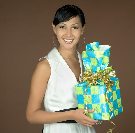 Young woman holding a present : Stock Photo