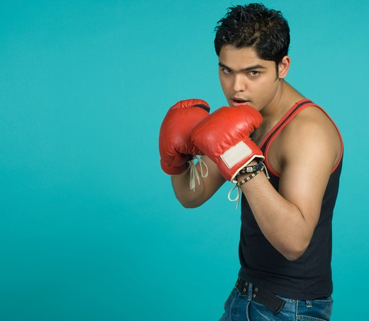 Teenager with boxing gloves : Stock Photo