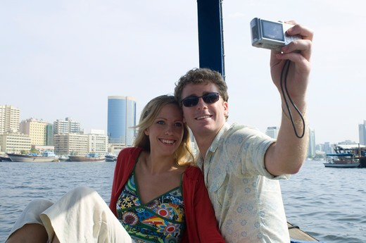 Couple on Abra at Dubai Creek, United Arab Emirates : Stock Photo