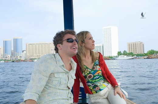 Stock Photo: 4304R-5243 Couple on Abra at Dubai Creek, United Arab Emirates