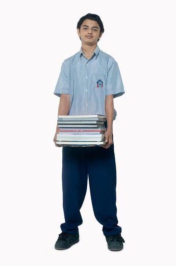 Stock Photo: 4304R-5382 Teenage boy carrying books