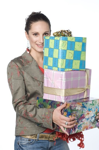 Young woman holding gift box, portrait : Stock Photo