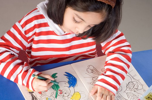 Stock Photo: 4304R-5572 Girl (6-7) coloring sketch, elevated view
