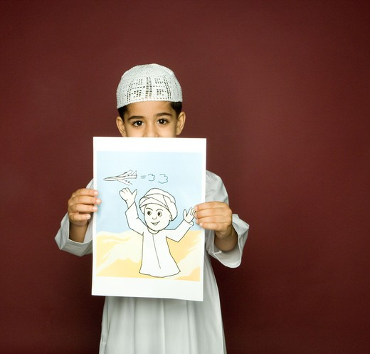 Stock Photo: 4304R-5672 Boy (8-9) holding painting, smiling, portrait