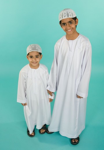 Brothers wearing traditional clothing, portrait, smiling : Stock Photo