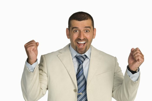 Stock Photo: 4304R-6739 Businessman clenching fists against white background, portrait