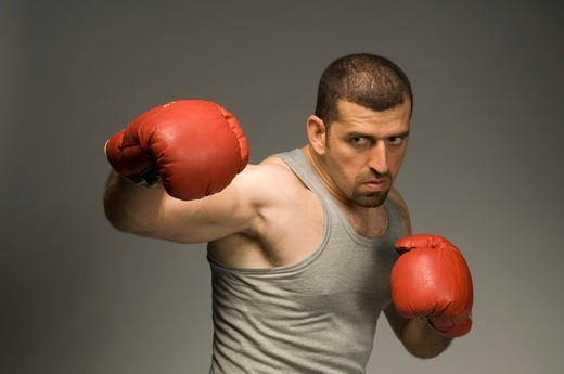 Mid adult man with red boxing gloves : Stock Photo