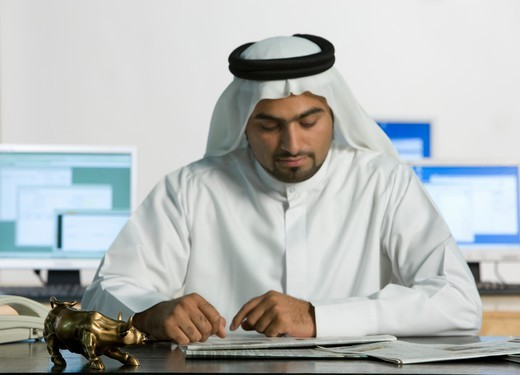 Stock Photo: 4304R-7014 Arab man reading newspaper