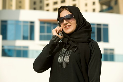 Stock Photo: 4304R-7105 Arab businesswoman talking on Cellphone, standing