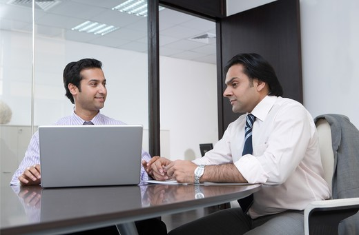 Stock Photo: 4304R-7365 Two businessmen having a meeting
