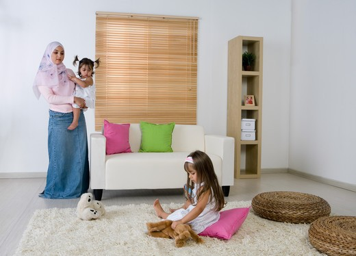 Mother with two daughter in the living room : Stock Photo