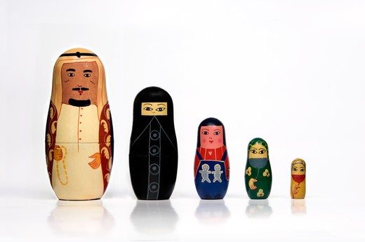 Stock Photo: 4304R-7775 Set of Arabian matryoshka dolls arranged in a row by order of size