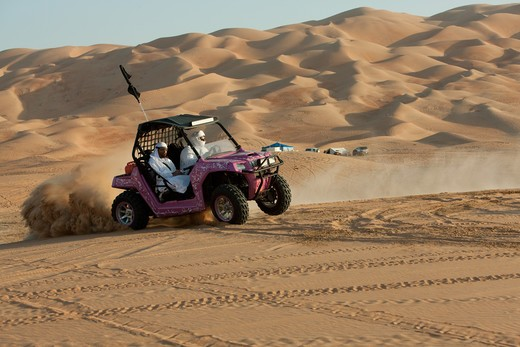 Stock Photo: 4304R-7783 Dune buggy riders seen in the desert of Liwa, Abu Dhabi - UAE