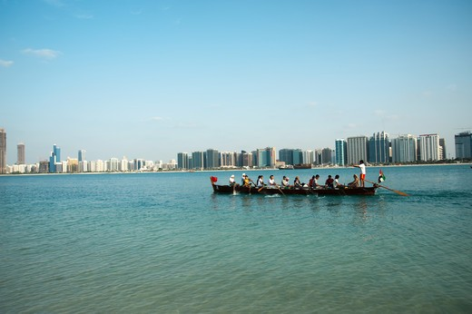 Stock Photo: 4304R-7832 Traditional Rowing Dhow with Abu Dhabi sky in background, UAE