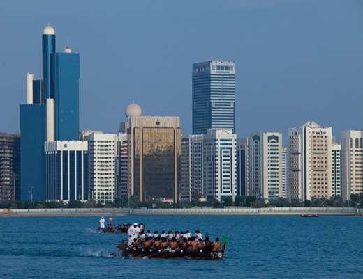 Stock Photo: 4304R-7844 Traditional Rowing Dhow with Abu Dhabi sky in background, UAE