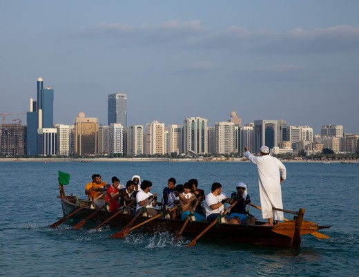 Stock Photo: 4304R-7846 Traditional Rowing Dhow with Abu Dhabi sky in background, UAE