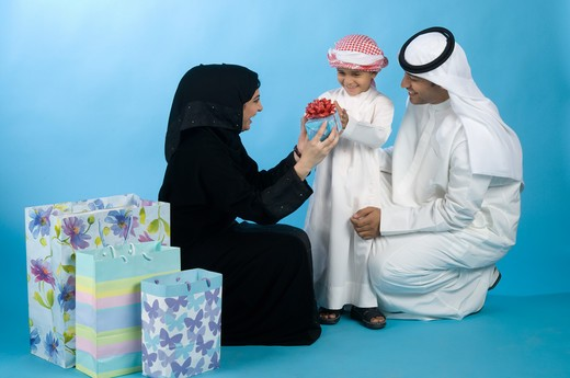 Stock Photo: 4304R-7896 Arab family with shopping bags & gifts