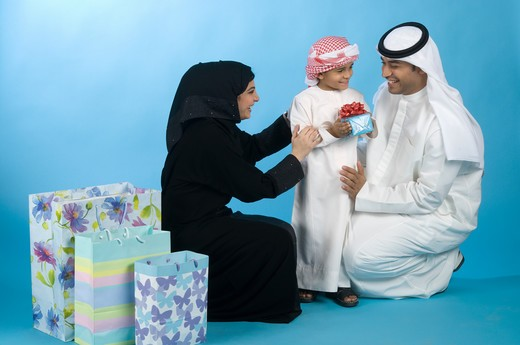 Arab family with shopping bags & gifts : Stock Photo