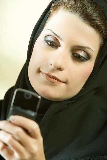 Stock Photo: 4304R-7989 Arab businesswoman talking on phone in the office