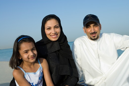 Stock Photo: 4304R-8132 Girl with parents on beach, smiling, portrait