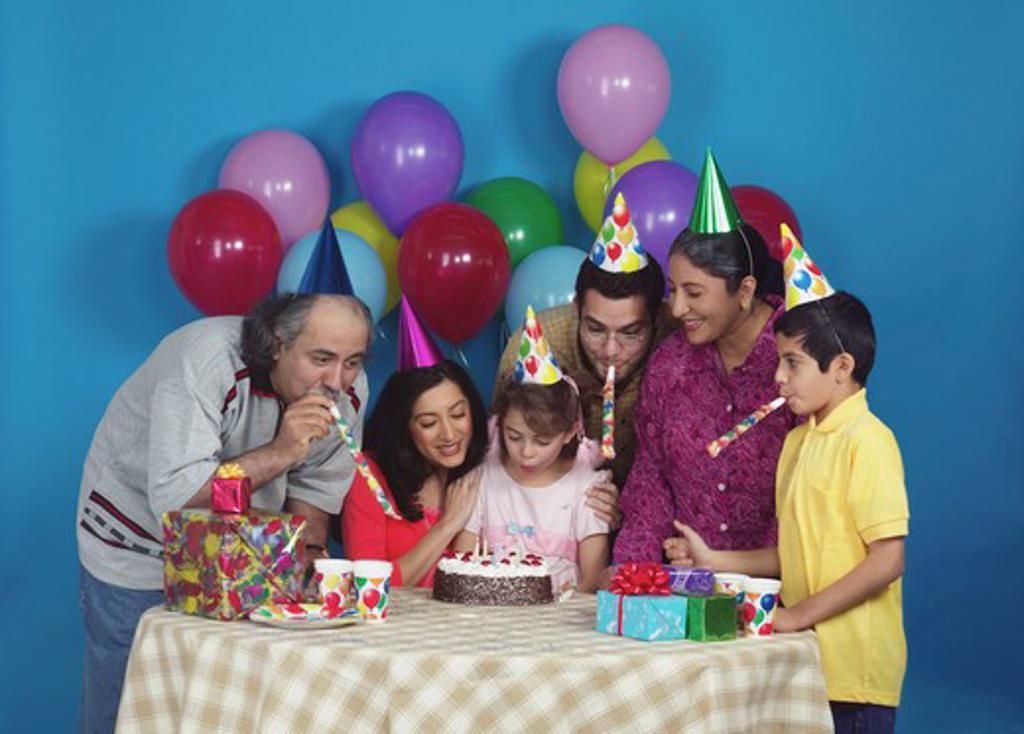 Stock Photo: 4304R-8369 Family celebrating a birthday party