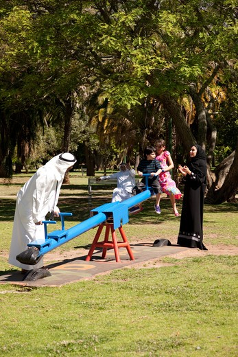 Stock Photo: 4305R-1087 Multi-generation arab family at the park, children riding on the seesaw.