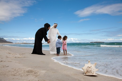 Arab family at the beach. : Stock Photo