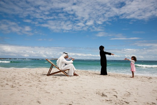Stock Photo: 4305R-1613 Arab family playing together at the beach.