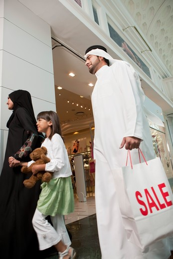 Stock Photo: 4305R-1618 Arab Family with shopping bags at the mall.