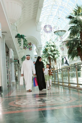 Stock Photo: 4305R-1619 Arab Family with shopping bags at the mall.