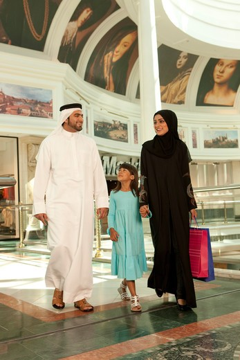 Stock Photo: 4305R-1631 Arab Family with shopping bags at the mall.