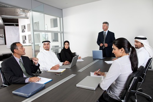 Stock Photo: 4305R-1928 Group of business people having a meeting.