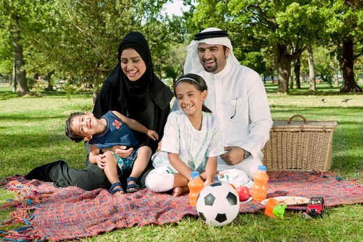Stock Photo: 4305R-1973 Portrait of arab family in the park, smiling.