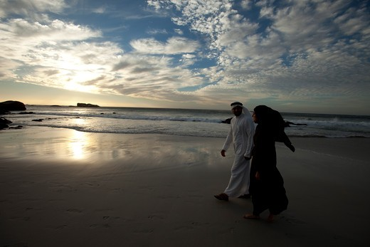 Stock Photo: 4305R-2021 Arab couple walking by the beach, holding hands.