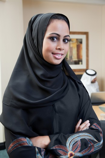 Portrait of arab businesswoman in meeting, smiling. : Stock Photo