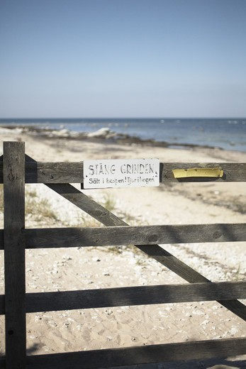 Stock Photo: 4306R-10078 A closed gate on a beach.