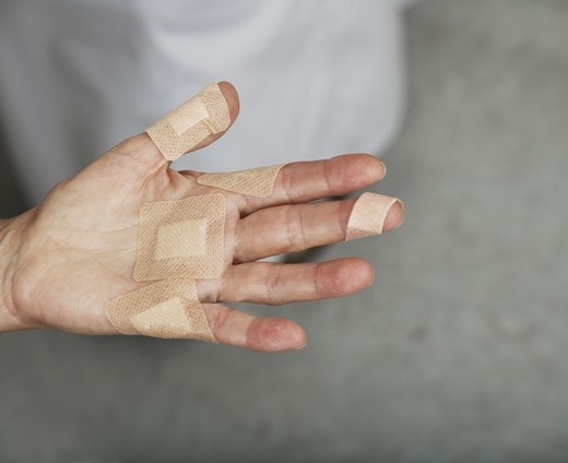 A hand with plaster. : Stock Photo