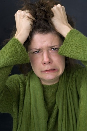 Stock Photo: 4306R-10489 Portrait of a woman in despair.