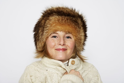 Stock Photo: 4306R-11114 Portrait of a woman wearing a fur hat.