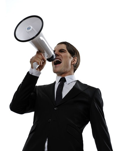 A man in a suit screaming in a megaphone, Sweden. : Stock Photo