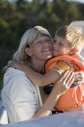 Mother and son hugging, Sweden. : Stock Photo
