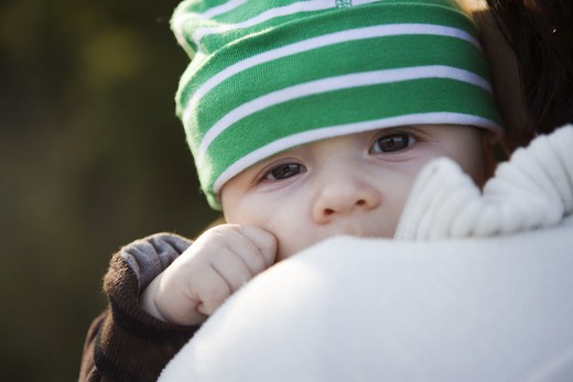 Stock Photo: 4306R-11833 A little baby wearing a green hat, Sweden.