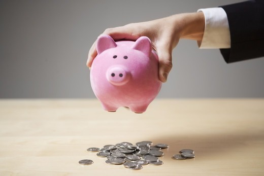 Stock Photo: 4306R-11892 A man holding a piggy bank.