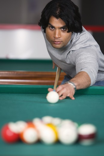 Stock Photo: 4306R-11917 A man playing pool.