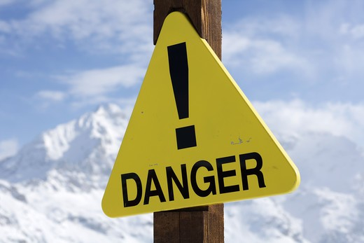 Stock Photo: 4306R-11954 A warning sign on a ski slope in the alps.