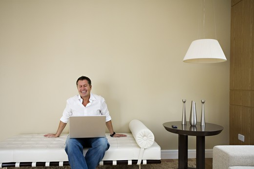 Stock Photo: 4306R-12172 A Scandinavian man using a laptop, Brazil.
