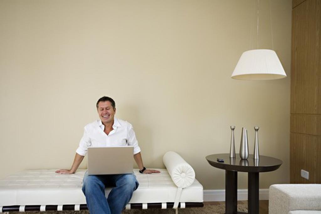 A Scandinavian man using a laptop, Brazil. : Stock Photo