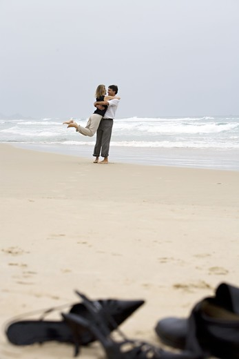 Stock Photo: 4306R-12183 A middle-aged couple embracing on the beach, Brazil.